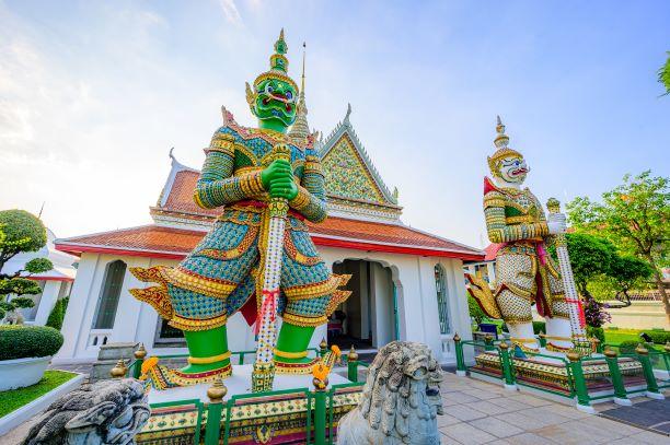 Giant at the entrance of Wat Arun Ratchawararam temple in Bangkok