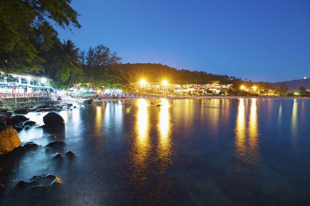 View of Karon beach - a popular tourist destination at night time. Phuket island, Thailand