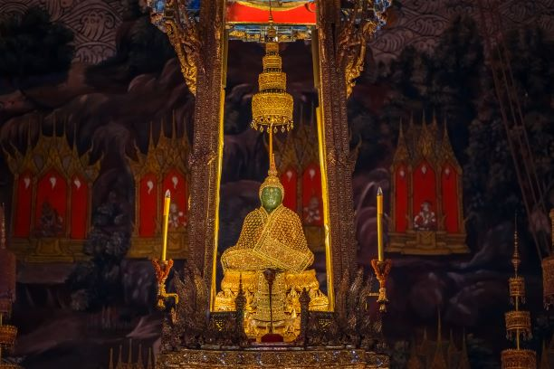 the emeral buddha change from Rainy to Winter attire-What Phra Kaew Bangkok