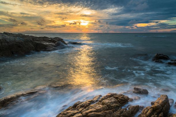 A beautiful sunrise and coral rock at chaweng beach of koh samui in thailand