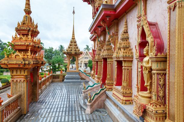 Buddha bas-relief and the bellfry of the Buddhist temple Wat Chalong Phuket Thailand