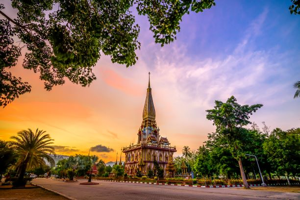 Pagoda in wat chalong or chalong temple with twilight