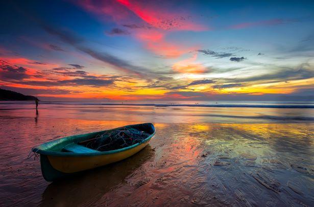 boat with colorful Sunset At Karon Beach Phuket , Thailand