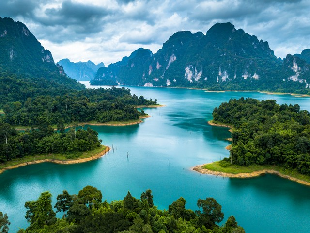 Aerial photos from drones on beautiful lake in mountain at Ratchaprapha Dam and Cheow Lan Lake, Khao Sok, Thailand