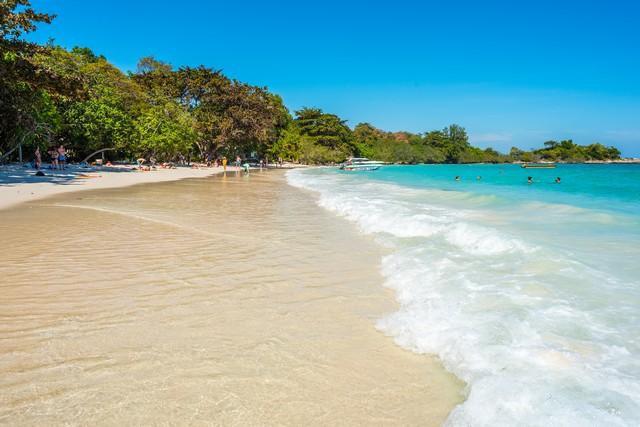 Ao Wai Beach - tourists enjoy the sand, surf and turquoise water