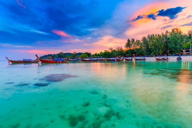 Beautiful sunset on white sand beach and Clear water