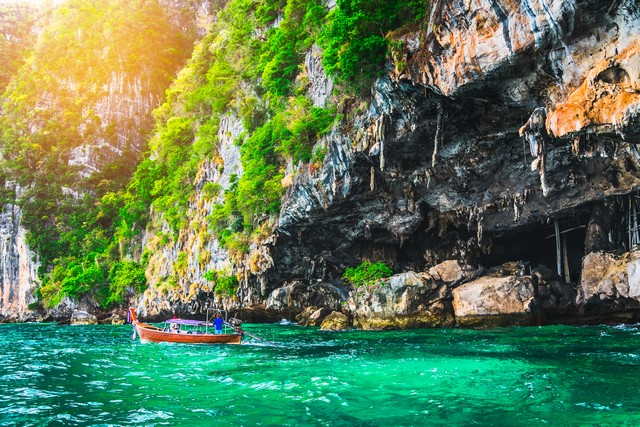 Landscape of Viking cave with longtail boat for traveler, Maya bay