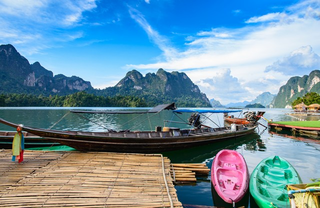 Long tail boat, a main transportation in Ratchaprapha Dam at Khao Sok National Park, Surat Thani Province, Thailand. Beautiful mountains and natural attractions. Kayaking, Recreation