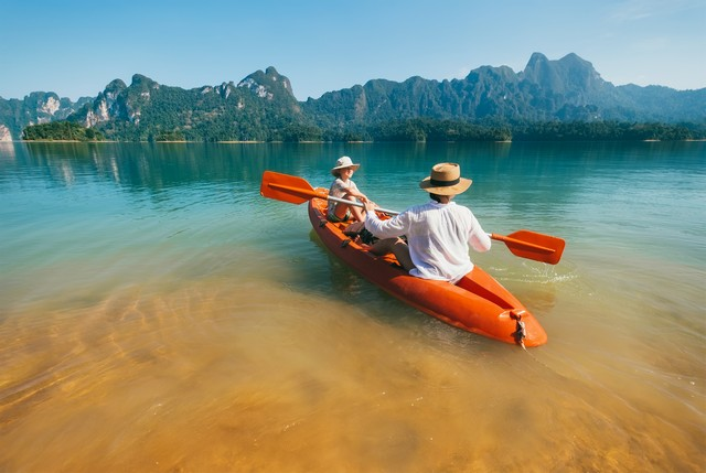Mother and son floating on kayak together