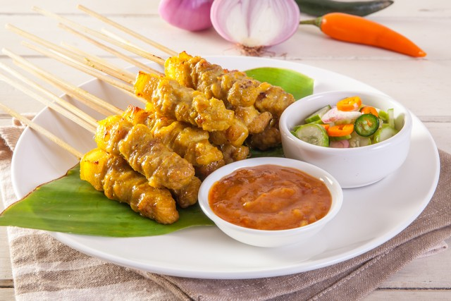 Grilled pork served with peanut sauce or sweet and sour sauce