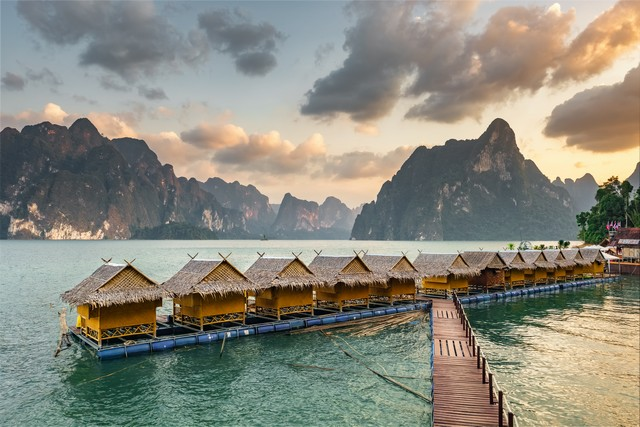 Raft houses on Cheow Lan lake in Khao Sok National Park at sunset, Thailand