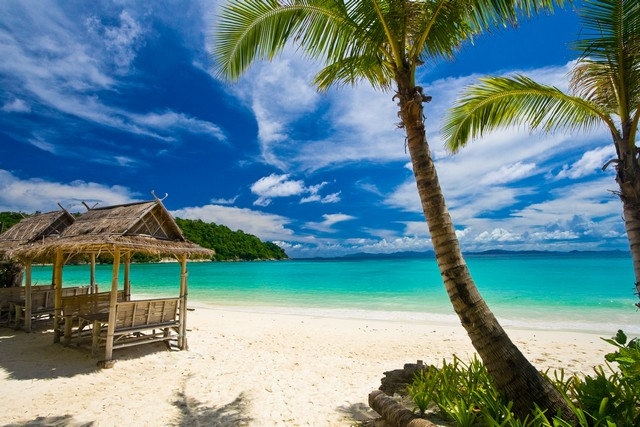 Siam Bay is on Racha Island, southeast of Phuket, Thailand.