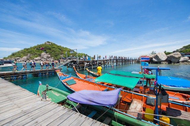Thai wooden boat for travel at port in Koh Tao , Thailand