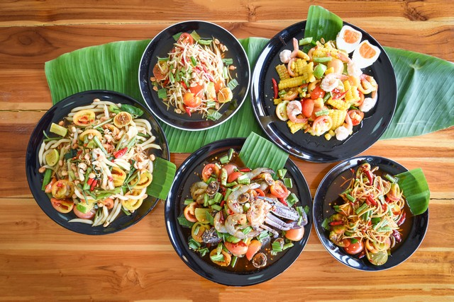 Variety of Papaya Salad put different ingredient, pork,corn,shrimp,egg