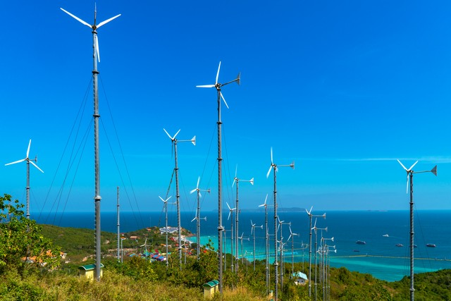 Wind mill power plant with blue sky on Larn island,Pattaya