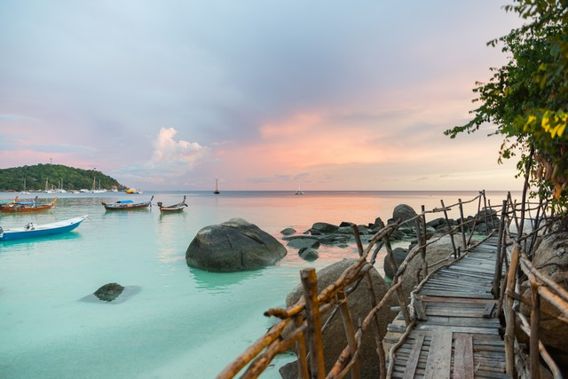 Wood bridge with sunset at pattaya beach