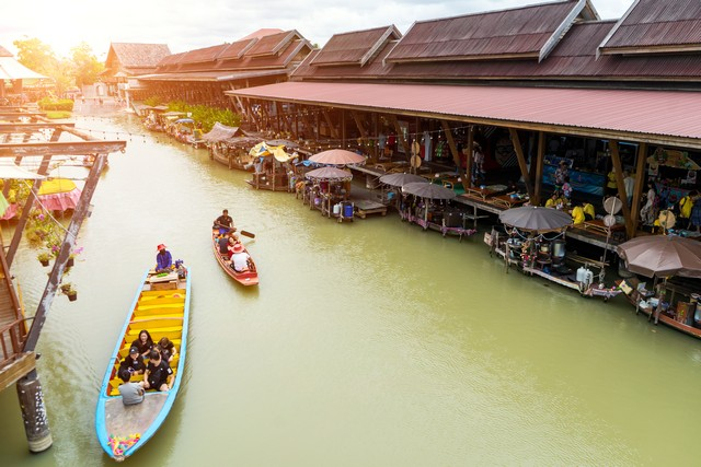 waterfront shop and local building,tourist take a boat to travel in the canal