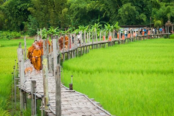 Monks walk on the bridge