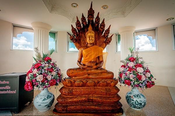 Floor 7: The Buddha statue in the attitude of Spreading Naga