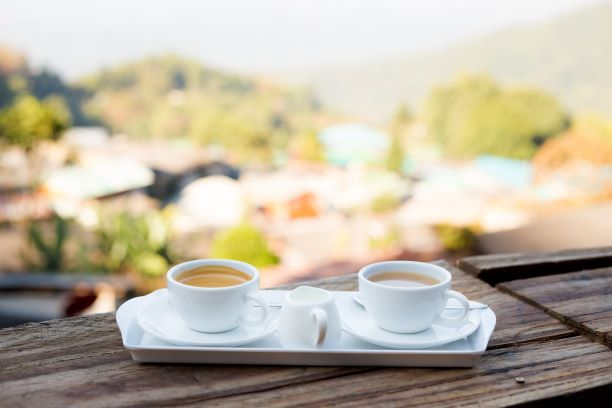 Coffee and tea in served in white china cups